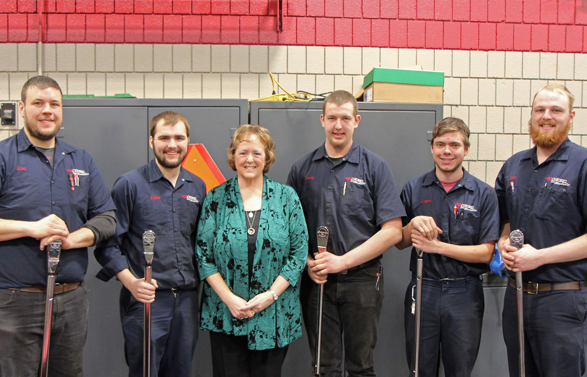 Diesel students with Karen Schenk, posing with the torque wrenches they received.