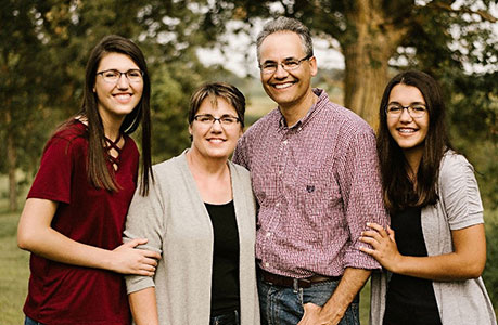 Randy Meyer with his wife Joan and two daughters